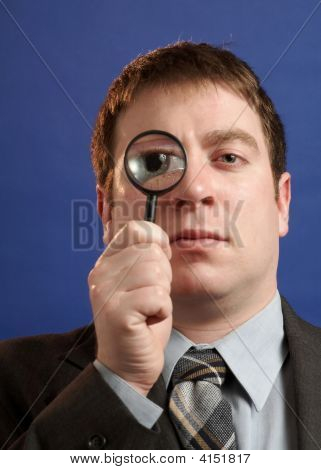 Businessman With Magniying Glass