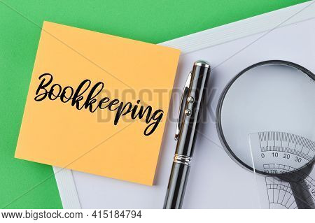 Memo Note Written With Text Bookkeeping. Top View