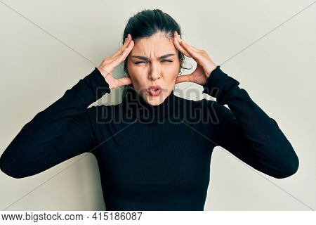 Young hispanic woman wearing casual clothes with hand on head, headache because stress. suffering migraine.