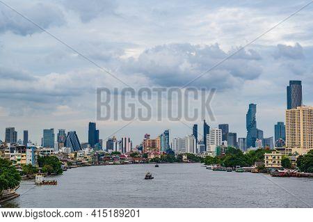 Bangkok/thailand- 04/07/2020-bangkok Cityscape With Beautiful Sunset And Chaophraya River.bangkok Is