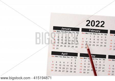 Close-up Of Pencil On Calendar 2022. Close Up Of Pencil On Calendar On White Using As Writing Agenda