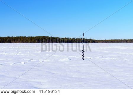 Ice Drill In The Snow On A Winter Lake. Winter Sports Winter Fishing. Space For Copying Text
