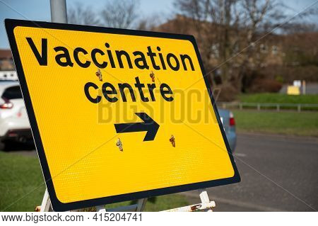 Amble, Northumberland, Uk - March 21, 2021: Vaccination Centre Temporary Road Sign With At The Side