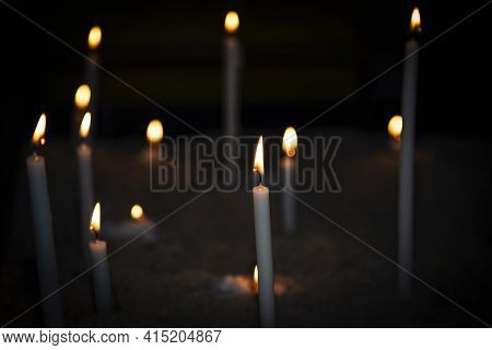 Candle Light. Candles Light In Dark Background. Candle Flames In Catholic Church. Bokeh Effect. Medi