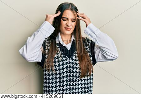 Beautiful brunette young woman wearing casual clothes with hand on head, headache because stress. suffering migraine.