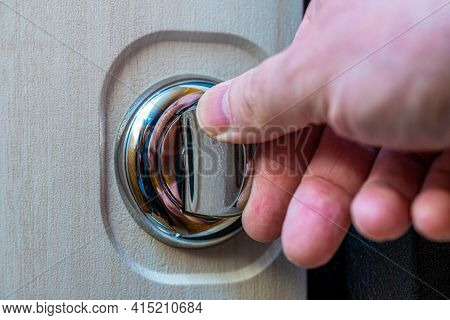 Close-up Of A Human Hand On A Round Door Latch. Door Furniture. Selective Focus. Focus On The Latch.