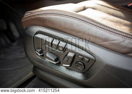 Detail Of New Modern Car Interior. Buttons For Adjusting Seat Position