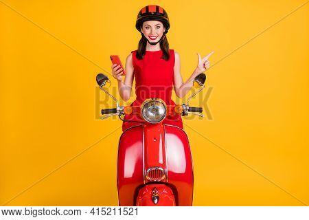 Photo Of Sweet Lady Wear Red Dress Headwear Sitting Retro Bike Holding Gadget Pointing Empty Space I