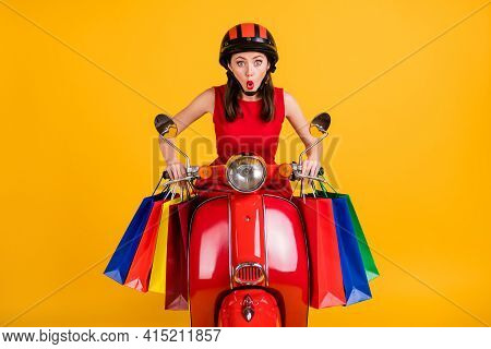 Photo Of Funny Woman Dressed Red Outfit Riding Fast Vintage Moped Holding Colorful Bargains Isolated