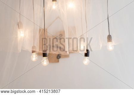 Glowing Incandescent Light Bulbs Element Of Decoration In An Interior Photo Studio