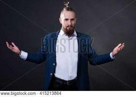 A Man With A Beard And A Fashionable Haircut In A Business Suit In The Studio On A Dark Background S