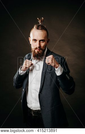 Portrait Of A Young Bearded Brutal Hipster Man, In A Fighting Stance In A Jacket And White Shirt In