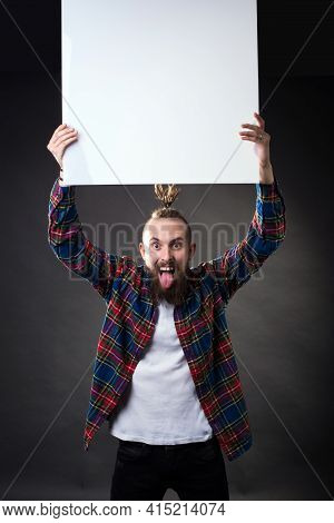 A Young Man With A Thick Beard And A Stylish Haircut Raised His Hands Up And Holds An Empty Letterhe