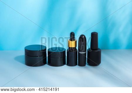 Set Of Cosmetic Packages Of Black Color, Clean, Black Without Labels, Tube Cream, Lipstick, Nail Pol