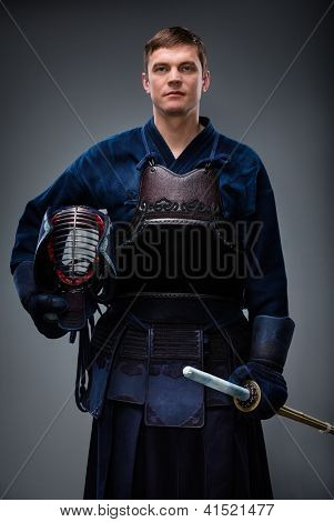 Kendoka with helmet and shinai in hands. Japanese martial art of sword fighting