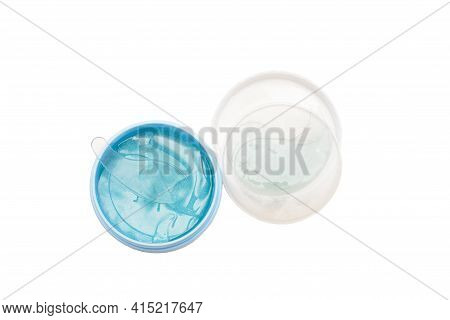 Hydrogel Blue Eye Patches In Container. Isolated White Background.