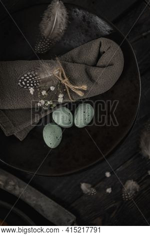 Plate With Green Chocolate Eggs Napkin And Small White Flowers. Ester Composition.