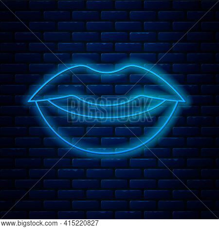 Glowing Neon Line Smiling Lips Icon Isolated On Brick Wall Background. Smile Symbol. Vector