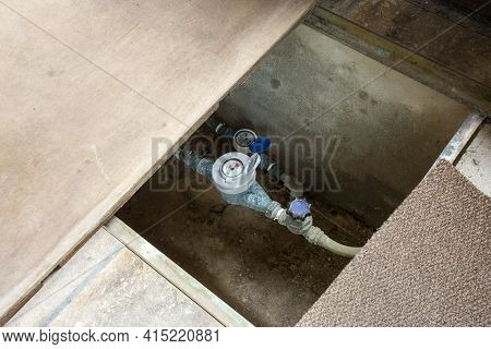 Indoor Hot Water Meters Used For Measuring Consumption Of Water In Buildings And Houses. In Crawl Sp
