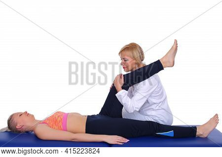 Physiotherapist Performs Thigh Muscle Relaxation Massage On A Young Patient