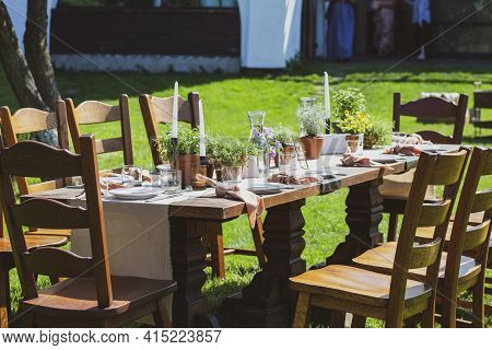 Banquet tables in nature. Wedding in the garden. Outdoor wedding. Buffet. Wedding banquet in nature.