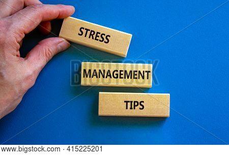 Stress Management Tips Symbol. Wooden Blocks With Words 'stress Management Tips'. Beautiful Blue Bac