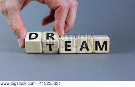 Dream Team Symbol. Businessman Turns Cubes And Changes The Word 'dream' To 'team'. Beautiful Grey Ta