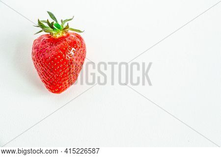 One Bright Strawberry On A White Background, Appetizing, Beautiful, Dietary. Place For Text, Copy Sp