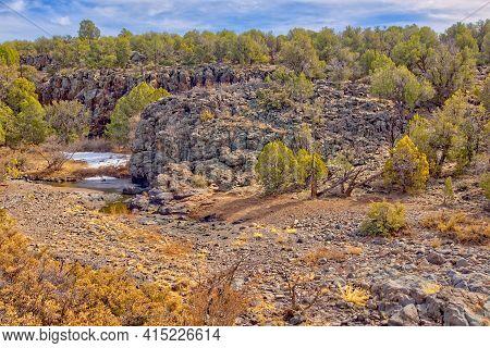 Basalt Cliffs Of Devil Dog Canyon Near Drake Arizona. Basalt Is An Igneous Volcanic Rock. Because It