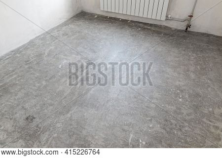 Prepared Concrete Floor In Empty Room For Pouring The Floor Covering With Self-leveling Mixture.