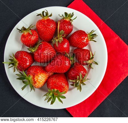 Appetizing Juicy Bright Strawberries On A White Plate On A Black Background - Vitamin Composition, T