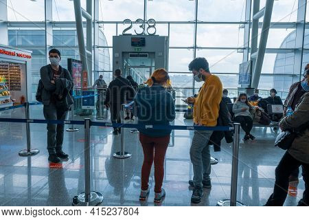 Gaziemir, Izmir, Turkey - 03.11.2021: People With Mask Waiting In Front Of Flight Gate In Aydin Mend