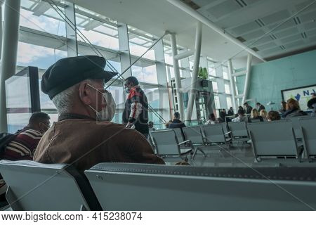 Gaziemir, Izmir, Turkey - 03.11.2021: An Old Man With Protective Mask Sitting On Chairs In Airport A