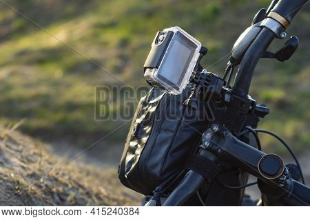 Action Camera On A Bike With A Bikepacking Bag In A Waterproof Case Against The Backdrop Of Nature.