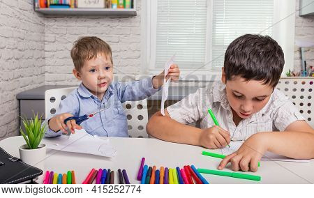 Happy Family Drawing Pictures. Cute Boys Studying Drawing At School. Kids Draw In Creativity At Home
