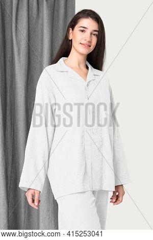 Woman in white pajamas nightwear studio shoot