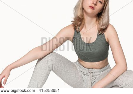 Blonde girl in sports bra and sweatpants activewear photoshoot