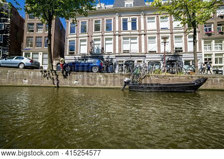Amsterdam, Netherlands - July 02, 2018: View Of The Embankment Of Amsterdam From A Pleasure Ship