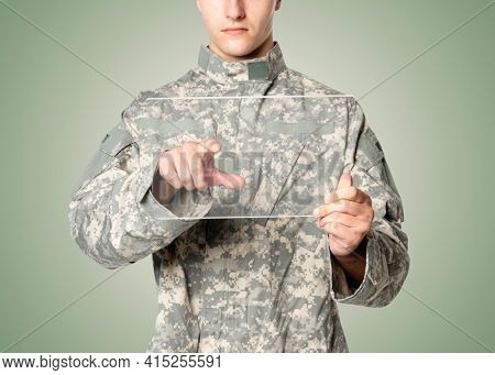 Military man using transparent tablet training military technology