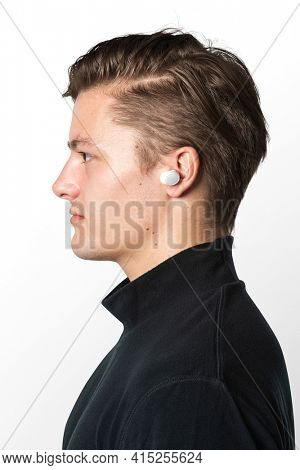 Man listening music with wireless earbuds
