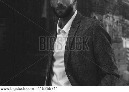 Businessman in formal attire black and white closeup portrait