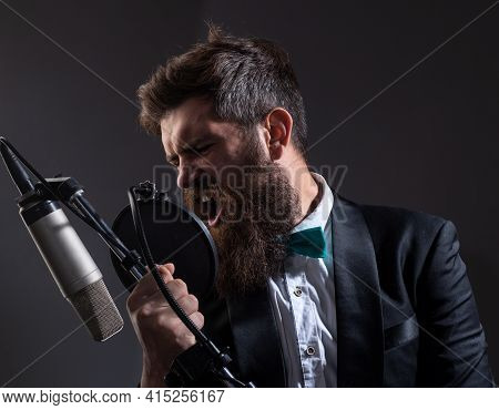 Man With Microphone Singing Song. Musician In Music Hall. Music Festival. Funny Guy Singing In Karao