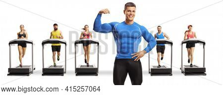Bodybuilder flexing muscle and people running on treadmills in the back isolated on white background
