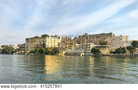 UDAIPUR, INDIA - JANUARY 14, 2017: City Palace. Located on Lake Pichola and built in a flamboyant style, is considered the largest of its type in the state of Rajasthan.