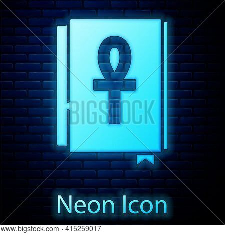 Glowing Neon Cross Ankh Book Icon Isolated On Brick Wall Background. Vector
