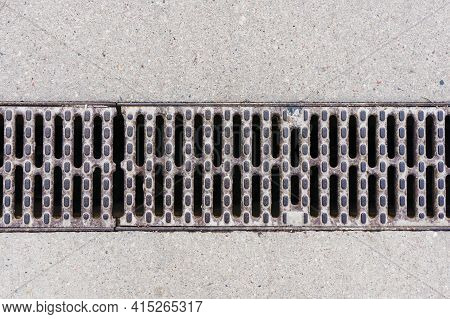 Manhole On Concrete Drain System Cover. Urban Sewer Background. Metal Drain Cover Texture. Empty Cop