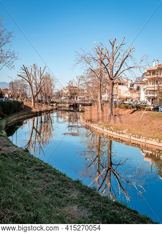 Trikala, Greece - February 6 2021: Reflections On The River Lithaios, The Landmark River That Crosse