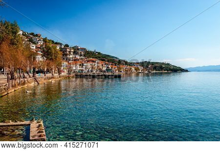 Afissos, Greece - March 28 2021: The Waterfront Ofafissos, A Traditional Village On The Slopes Of Mo
