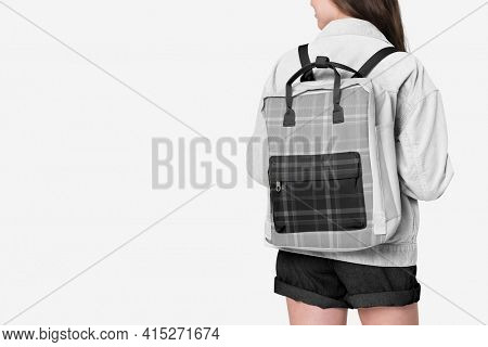 Student with gray flannel backpack with design space