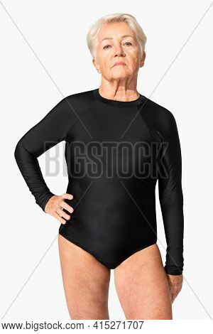 Mature woman in black one-piece swimsuit summer apparel